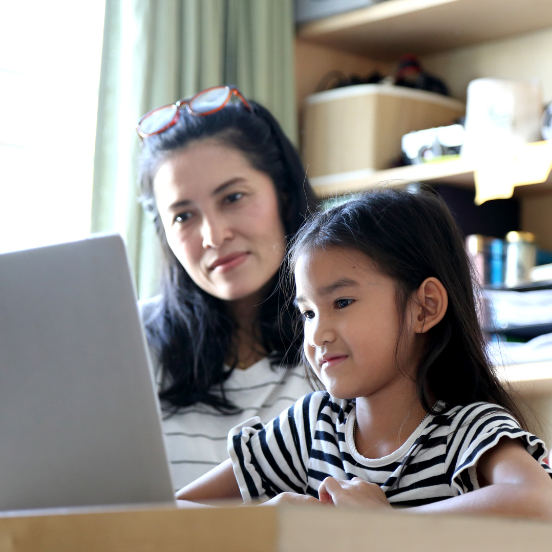 Mom and child on laptop